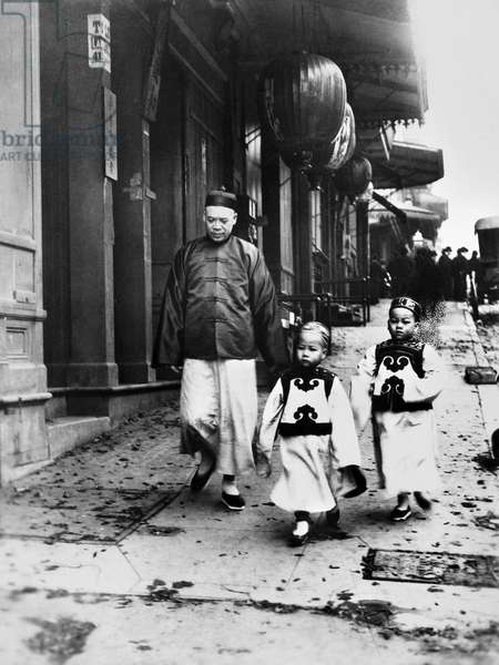 SAN FRANCISCO: CHINATOWN Children of a wealthy Chinese man walking down a street in Chinatown, San Francisco, California. Photograph, early 20th century.