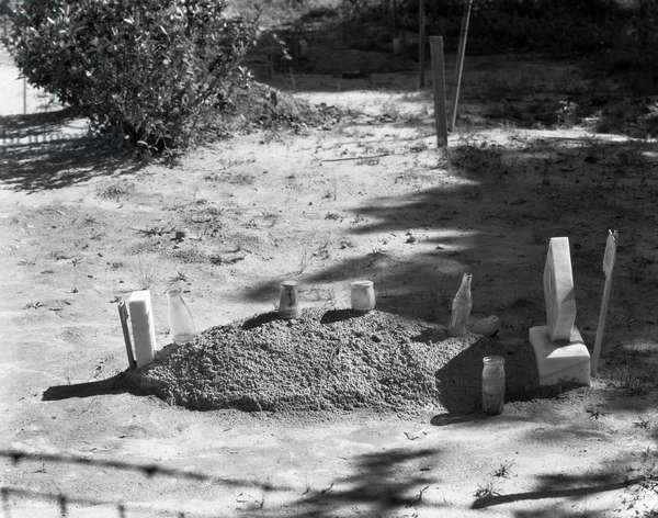ALABAMA: GRAVE, c.1935 Sharecropper's grave in Hale County, Alabama. Photograph by Walker Evans, c.1935.