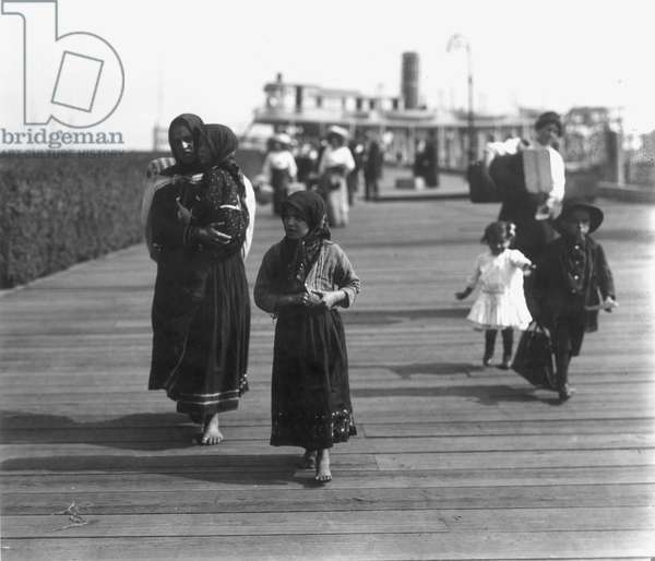 ELLIS ISLAND, EARLY 1900s Leaving the Ellis Island ferry.