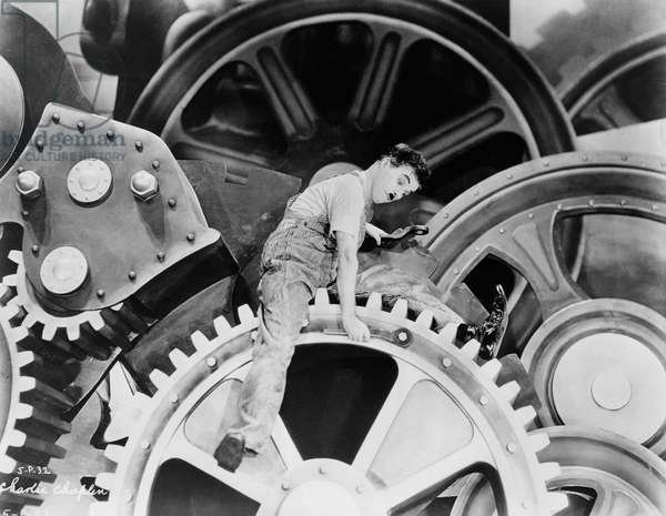 Charles Chaplin, on set of the film 'Modern Times', 1936 (b/w photo)