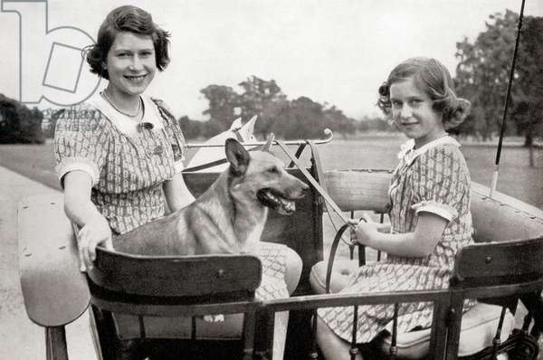 Princess Elizabeth, future Queen Elizabeth II, left, and Princess Margaret, right, driving a pony and trap in Great Windsor Park, England, 1941