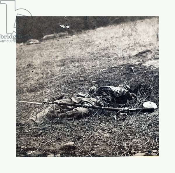 American Civil War: War Effect of a Shell on a Confederate Soldier at Battle of Gettysburg, Emains of a Dead Soldier on the Battlefield. Photo, Albumen Print
