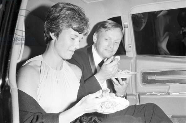 Neil Armstrong and his wife eating pasta (b/w photo)