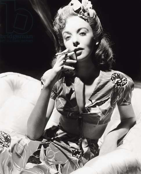 Ida Lupino smoking a cigarette