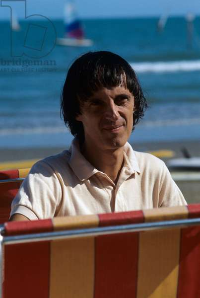 Dario Argento posing at the beach