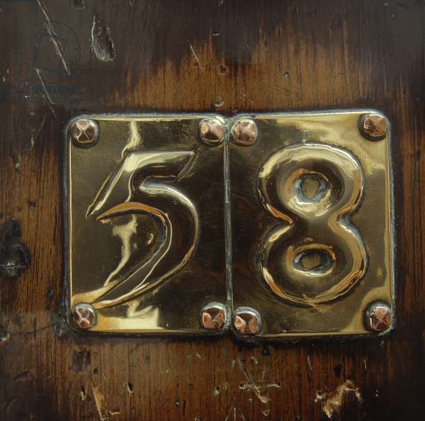 Glasgow School of Art, raised brass door number (photo)
