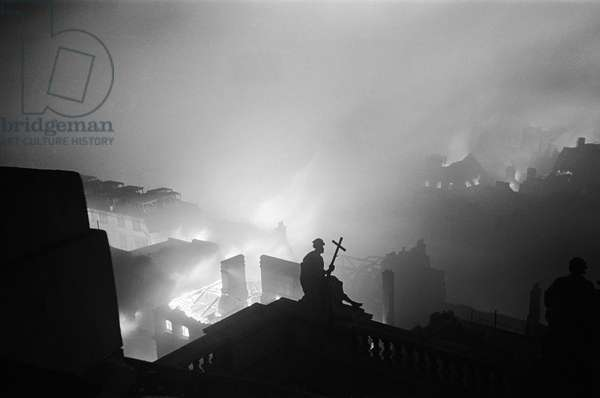 Fires raging around St. Paul's Cathedral during the night of bombing on 29th December 1940 (b/w photo)