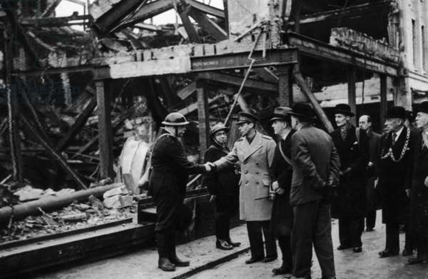 King George VI meets air raid wardens during his visit to the bomb damaged city of Bristol, December 1940 (b/w photo)