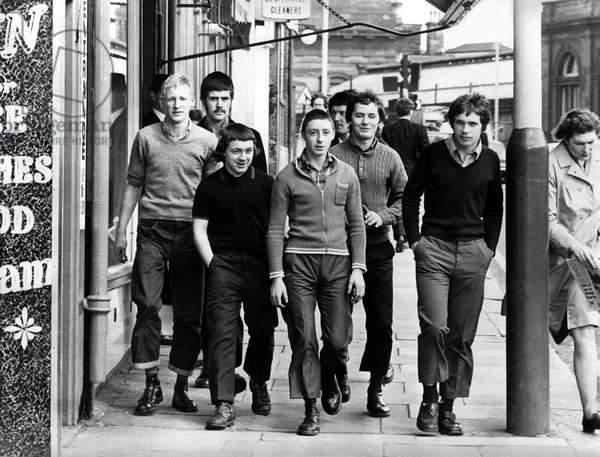 A group of skinheads walking around the streets of Newcastle, 8th June 1972 (b/w photo)