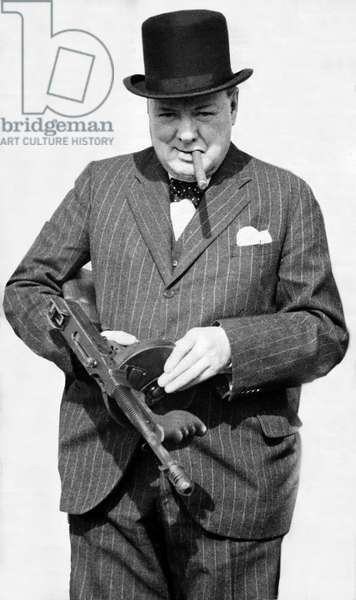 Winston Churchill holding a Tommy Gun and Smoking a Cigar, August 1940 (b/w photo)