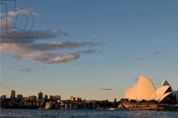 Northward view of the Sydney Opera House in Sydney Harbor at sunset (photo)