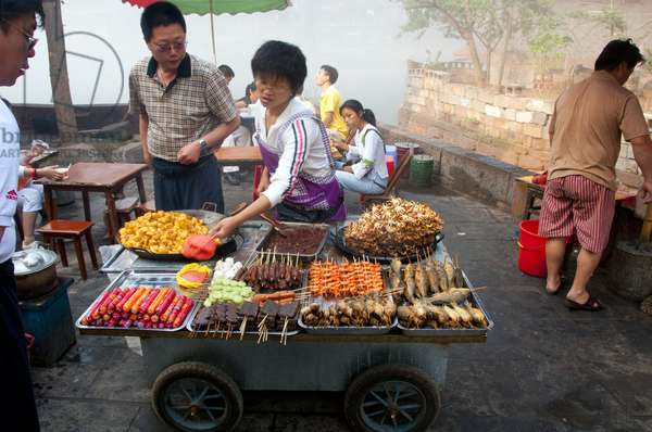 China: Snack vendor near the Wanming Pagoda, Fenghuang, Hunan Province