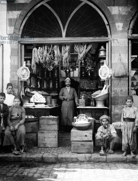 Palestine: A grocers shop and hardware store, Jerusalem, c. 1910