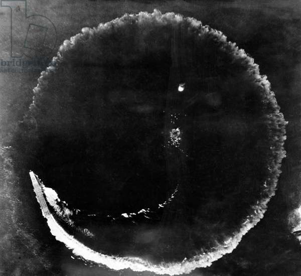Japan: Aerial photograph of the Imperial Japanese Navy aircraft carrier 'Soryu' circling as an evasive maneuver while under attack from United States Army Air Force Boeing B-17E Flying Fortress bombers, Battle of Midway, 4 June 1942