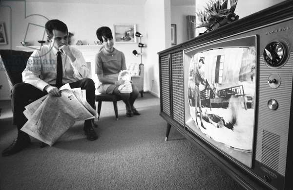 USA / Vietnam: 'War Comes to the Living Room'. An American couple watching film footage of the Tet Offensive on a television in their living room, Warren K Leffler, 1968