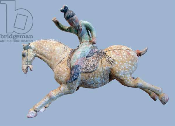 China: Tang dynasty ceramic horse with polo player.