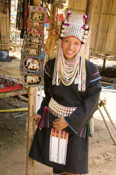 Thailand: Akha woman selling traditional handicrafts at a village in northern Thailand