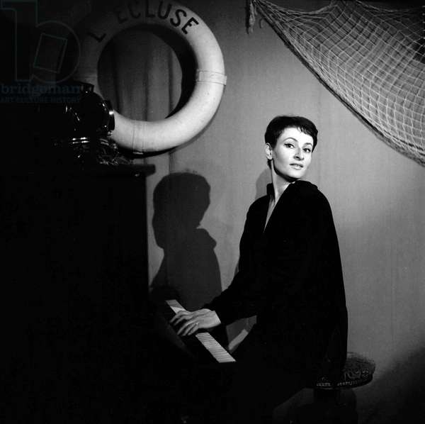 French singer Barbara ( Monique Andree Serf) for the first time singing on stageat L'Ecluse (cabaret), Paris, in 1954 (b/w photo)