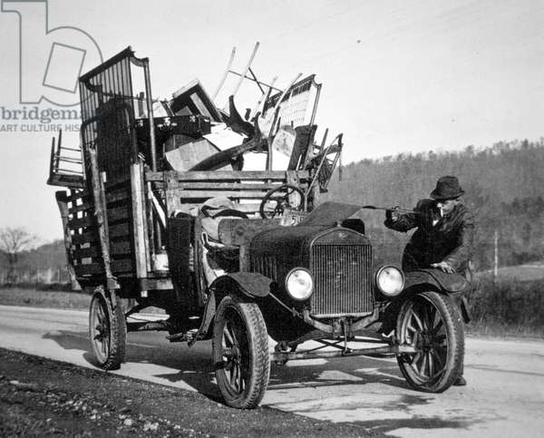 Dust bowl farmer moving his household goods, Hamilton County, Tennessee, 1936 (b/w photo)