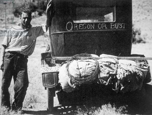 Verna Evans, dust bowl migrant from South Dakota heading for Oregon, July 1936 (b/w photo)