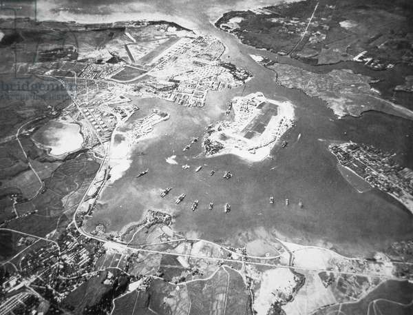 Aerial view of Ford Island and Battleship Row, Pearl Harbor, 1941 (b/w photo)