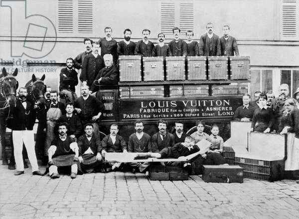 In the courtyard of the Asnieres workshops, around 1888, Louis, Georges and Gaston L. Vuitton (sitting on a Bed trunk)