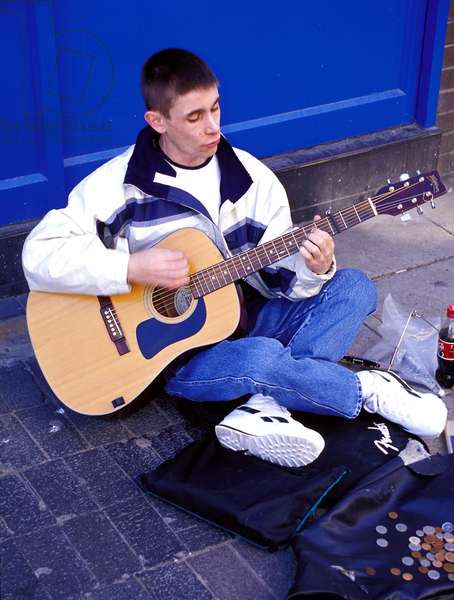 Busker Playing Guitar
