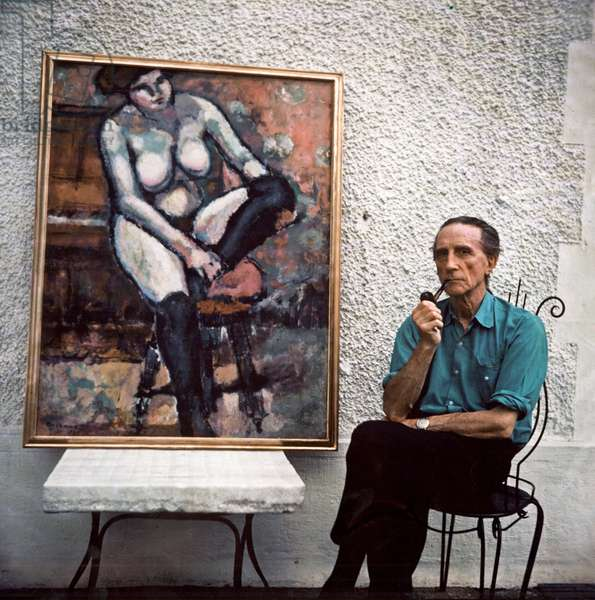 Marcel Duchamp posing near a canvas in his workshop, c.1957 (photo)