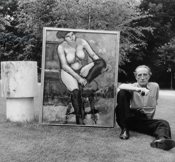 Marcel Duchamp posing near a canvas, c.1957 (b/w photo)