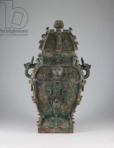 Covered wine vessel (fang lei) with design of zoomorphic masks and animal-headed handles, late 11th century BC (bronze)