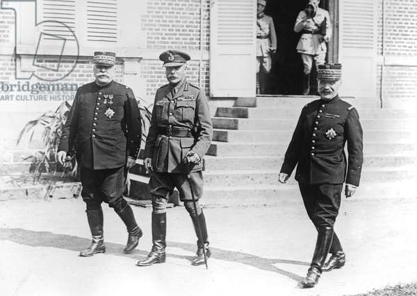 English commandant Douglas Haig with French officers general Joffre and marshal Foch leaving the commander in chief's chateau Beauquesne august 1916 after huncheon with kingGeorges (time of battle of Somme)