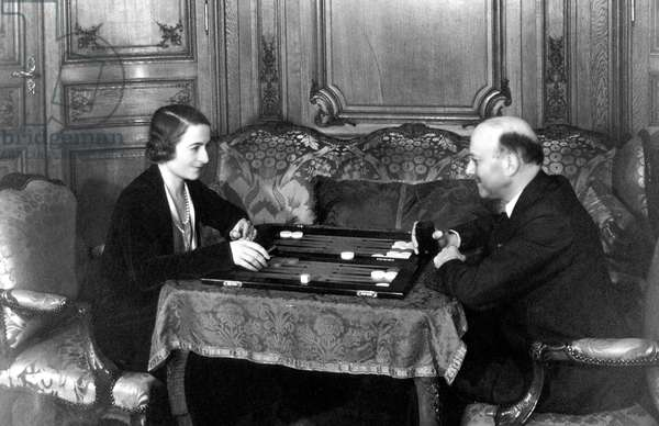 Andre Citroen (1878-1935) French car manufacturer and his wife Georgina Bingen, playing backgammon c. 1930