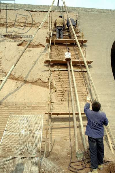 The picture taken on Nov. 5, 2005 shows workers repair the southern gate of Pingyao, an ancient city in north China's Shanxi Province