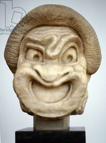 Ancient Greek theatrical mask representing Comedy. Stone carving. 3rd century BC.