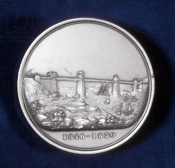 Britannia Tubular Bridge over Menai Straits between Welsh mainland and Angelsea. Chester and Holyhead Railway. Begun 1846, opened 18 March 1850. Engineer Robert Stephenson. Box girder bridge. Reverse of of medal commemorating the building of the bridge.