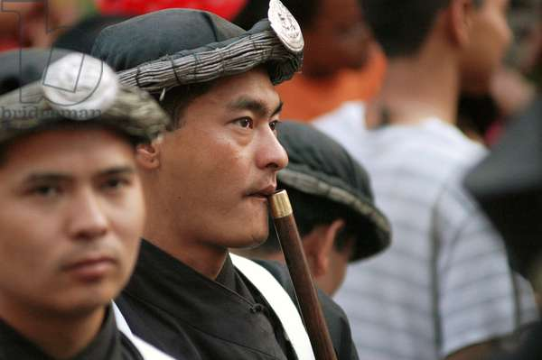 A person playing a flute in one of the cultural gathering of Nepalese people called 'Lupton'. Nepal.  (photo)