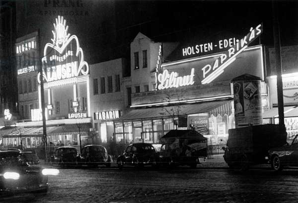 Fronts and neon lights of the nightclubs at Hamburg Reeperbahn, 1950s