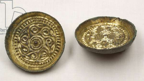 Anglo Saxon saucer brooches, 5th-7th century AD (gilded bronze)