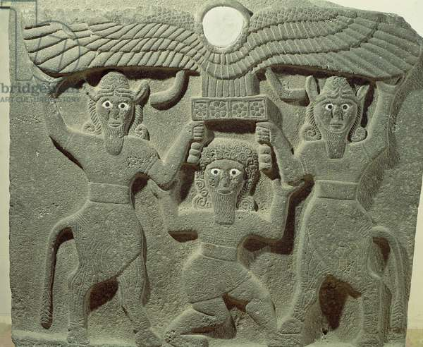 Relief depicting Gilgamesh between two bull-men supporting a winged sun disk, from Tell-Halaf, Syria (stone)