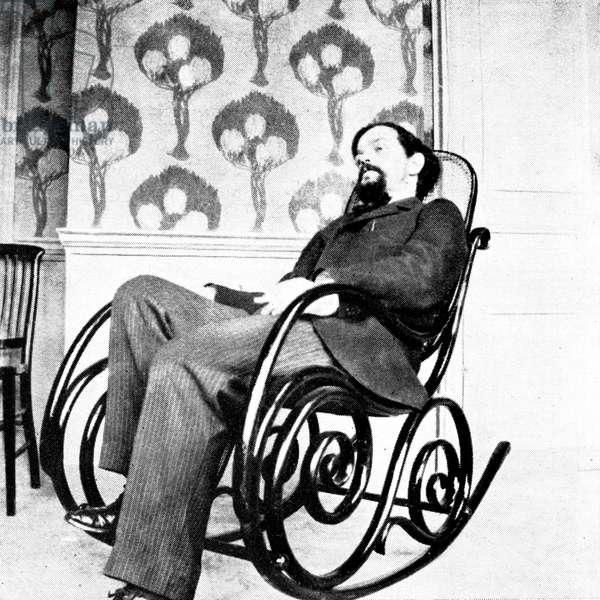 Claude Debussy portrait - seated in rocking chair