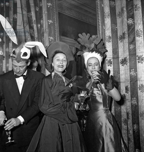 Elsa Schiaparelli Dressed As A Radish , With Mrs Winsonr Dressed As A Tomato at Four Seasons Fancy Dress Ball The Gentleman Seems To Be Dressed As A Rabbit March 24, 1949 (b/w photo)