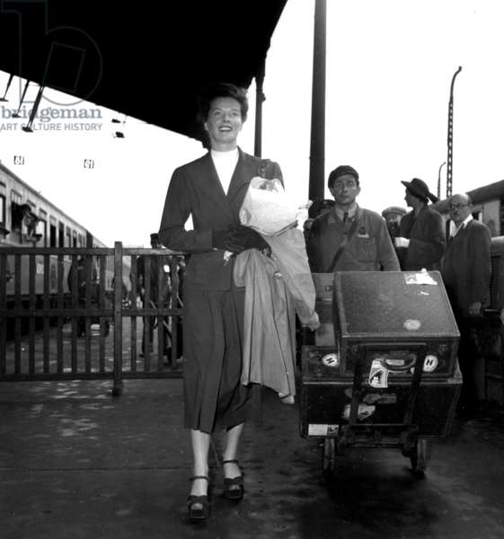 Katherine Hepburn Arriving With Vuitton Luggages in Paris Railway Station July 19, 1948 (b/w photo)