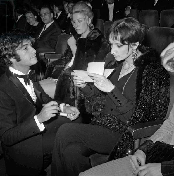 French actor Jean Claude Brialy and singer Barbara (Monique Andree Serf) at premiere of singer -Adamo at the Olympia, Paris, January 10, 1969 (b/w photo)