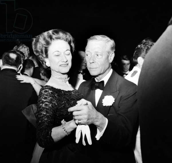 Duke Edward and Duchess (Wallis Simpson) of Windsor December 10, 1959 at Lido, Paris. The Duchess Is Wearing A Diamonds Necklace By Cartier (-1937) and A Tiger Bracelet By Cartier (-1956) (b/w photo)