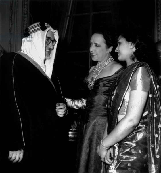 Minister of Saudi Arabia, With Elsa Schiaparelli and A Young Pakistani Woman at Pakistan Embassy Reception in Paris March 28, 1952 (b/w photo)
