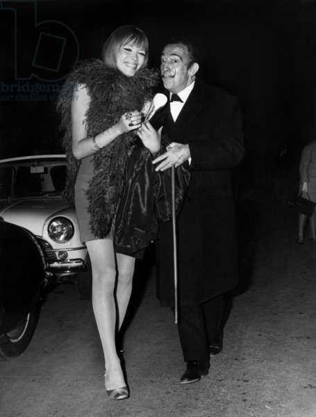 Spanish Pintor Salvador Dali With French Singer and Presenter Amanda Lear, Arriving To The Gala