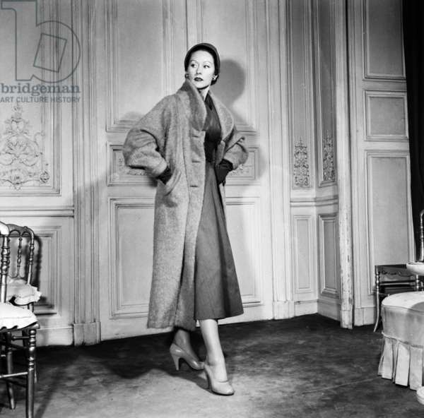 Fashion By Elsa Schiaparelli For Spring Summer 1953, February 18, 1953, Paris : Dress and Coat (b/w photo)