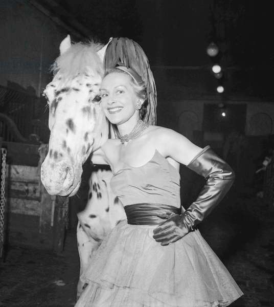 Rehearsal of the Gala of Union, Cirque d'Hiver, Paris, February 20, 1952 : French actress Helene Perdriere (dress by Elsa Schiaparelli) (b/w photo)