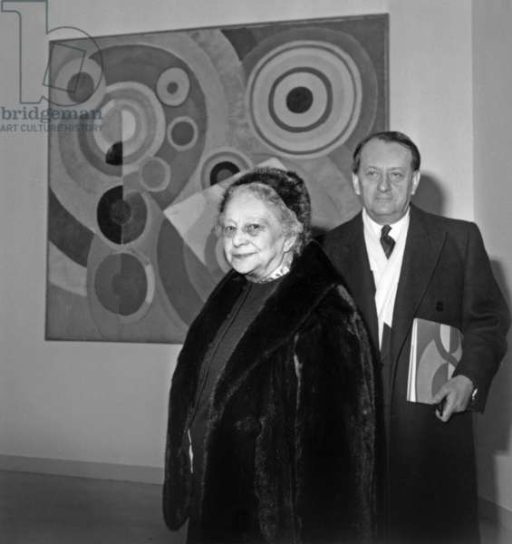 Sonia Delaunay and French Minister of Culture Andre Malraux in Front of A Painting By Robert Delaunay at Museum of Modern Art in Paris on February 27, 1964 (b/w photo)