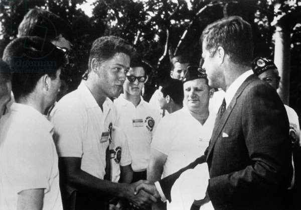 Young Bill Clinton shaking hands to President John F Kennedy in 1963 during reception at the White House in Washington
